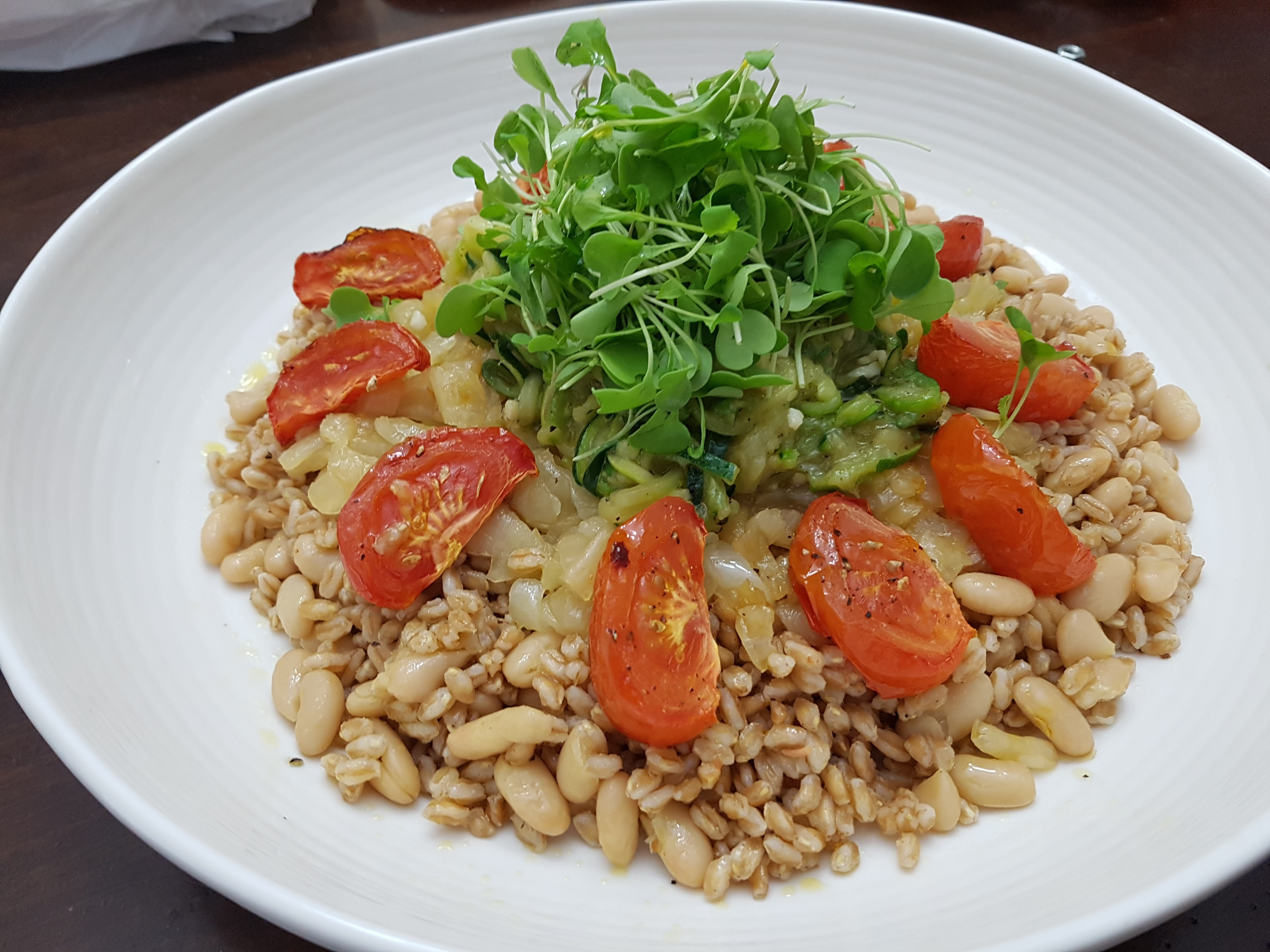 Farro and White Kidney with Zuccini, oven roasted tomatoes and caramelized Onions